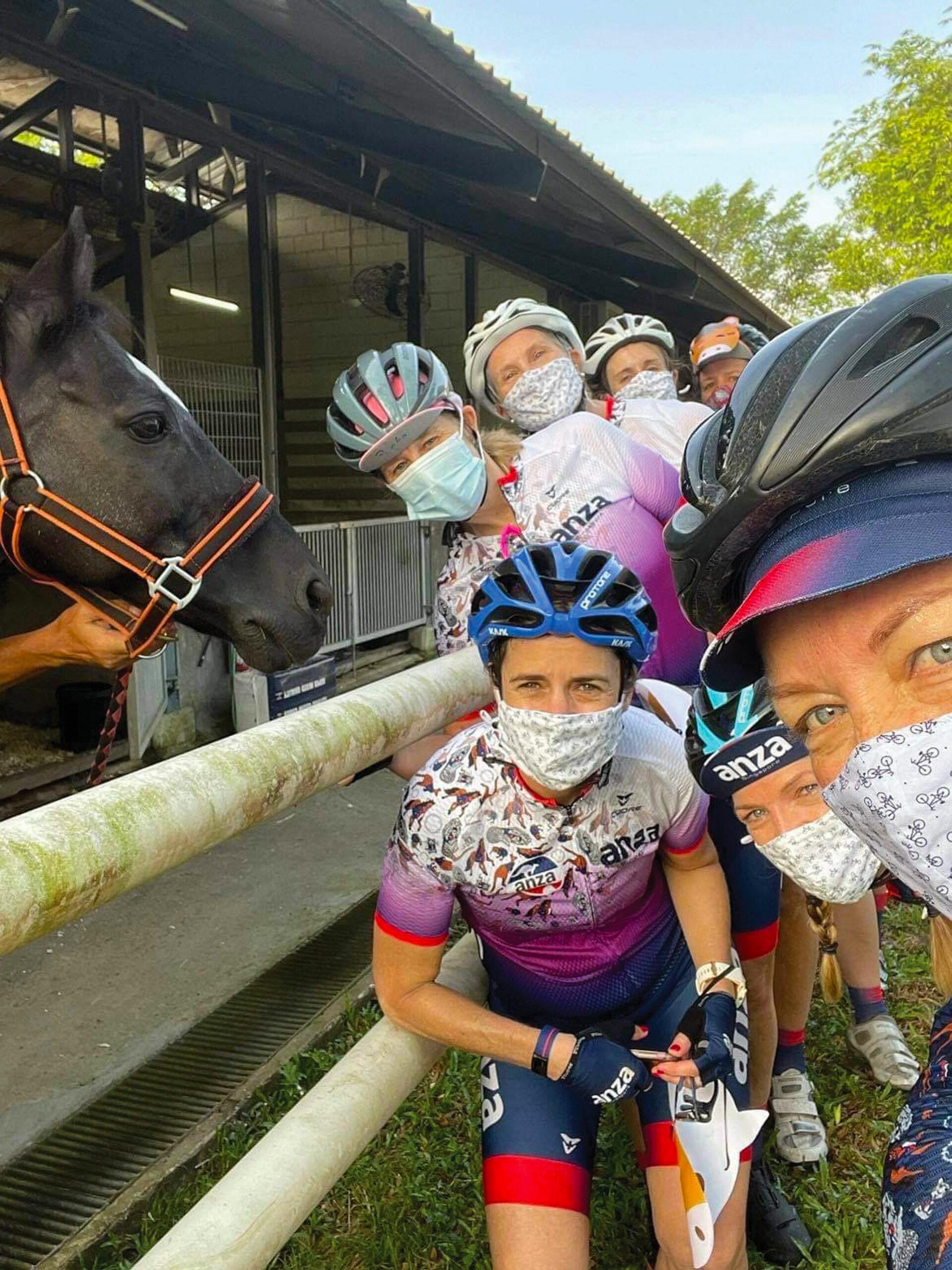 cyclists at horse barn