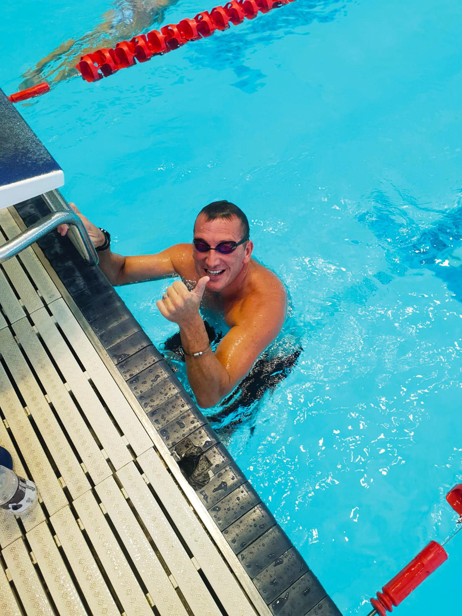Callum Eade, person training in swimming pool