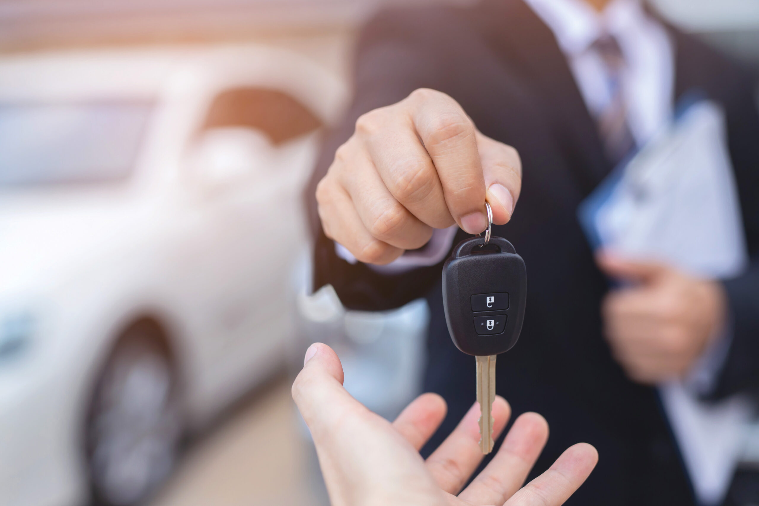 person holding car key
