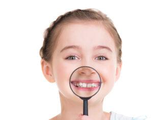 Girl showing healthy teeth